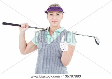 Pretty blonde playing golf and showing a thumbs up on white background