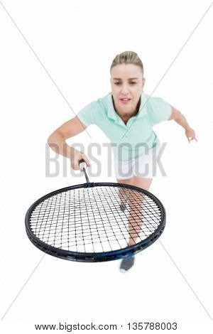 Pretty blonde playing badminton on white background