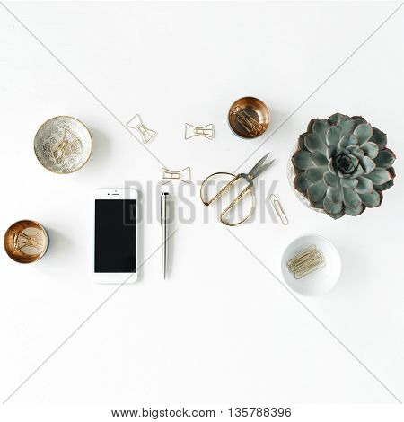 feminini desk workspace with succulent phone scissors and golden clips on white background. flat lay top view
