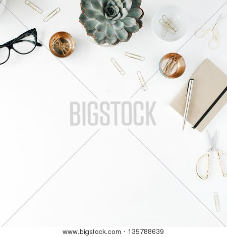 feminini desk workspace with succulent scissors diary glasses and golden clips on white background. flat lay top view