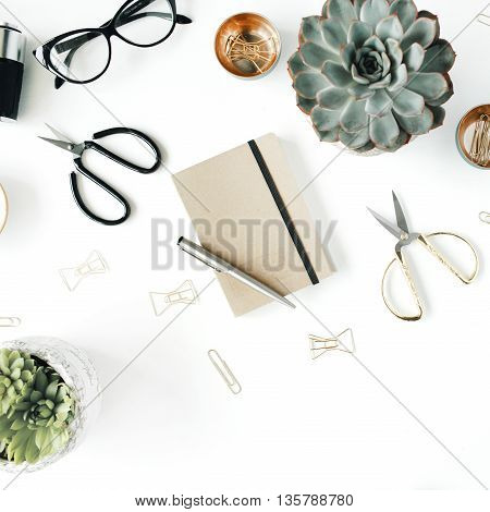 feminini desk workspace with succulent retro camera scissors diary glasses and golden clips on white background. flat lay top view