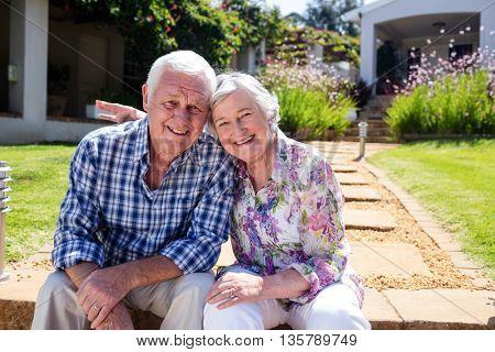 Happy senior couple embracing in the garden