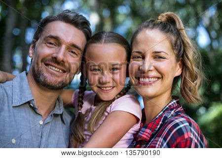 Portrait of happy family embracing in back yard