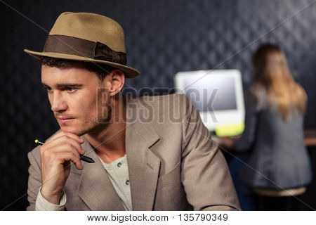 Creative businessman using computer and graphic tablet in office