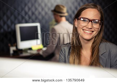 Creative businesswoman smiling at the camera in office