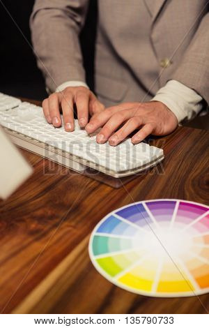 Creative businessman using computer in office