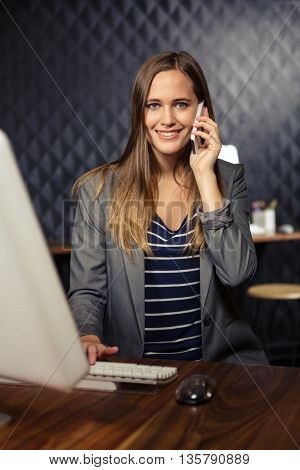 Creative businesswoman having a phone call in office