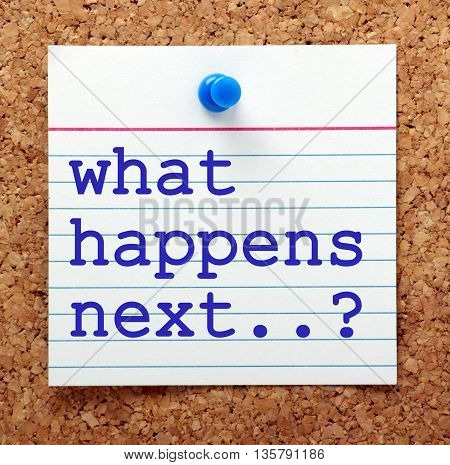 The question What Happens Next in blue text on a note card pinned to a cork notice board