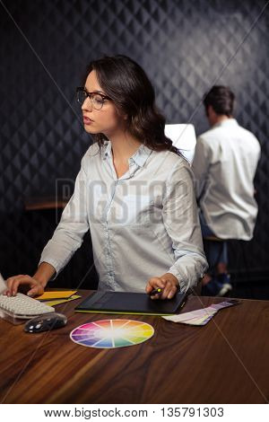 Creative businesswoman working on computer in office