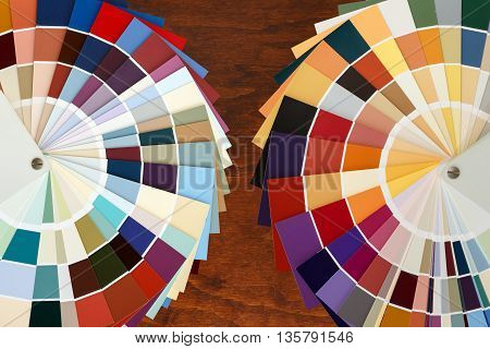 Two color palette guide on the wooden background