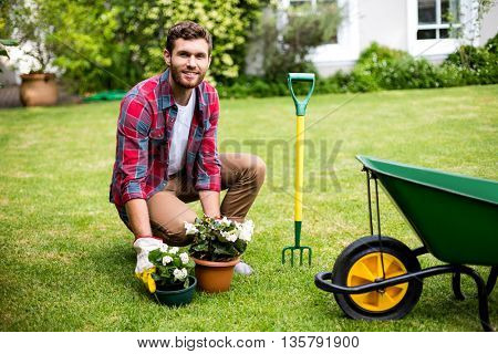 Portrait of smiling man woking in yard
