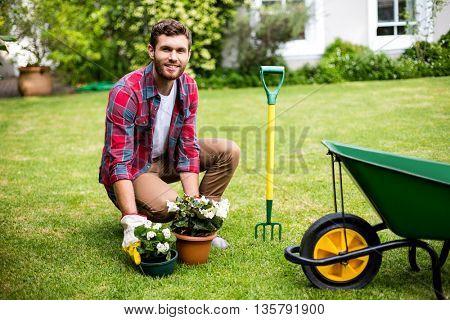 Portrait of smiling man woking in yard