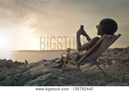 Woman chatting at the seaside