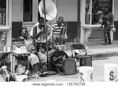 NEW ORLEANS, USA - MAY 14, 2015: Band playing live music on Royal Street in French Quarter. The picture is monochrome.