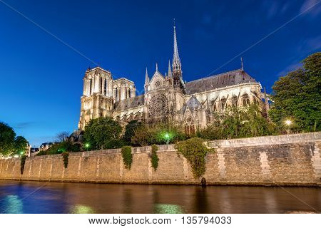 Notre-Dame and the River Seine in Paris at night