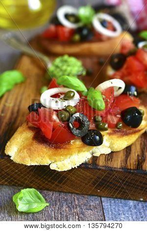 Bruschetta With Tomato,black Olives,capers And Sauce Pesto.