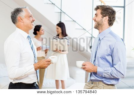 Businessmen interacting during a break time in the office