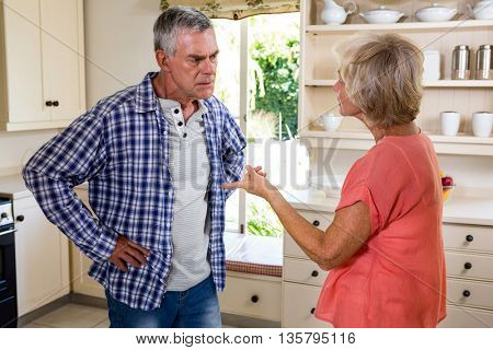 Senior woman fighting in kitchen at home