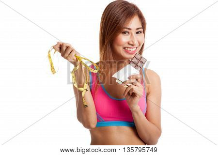 Beautiful Asian Healthy Girl With Chocolate And Measuring Tape