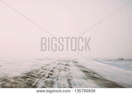 Snow-covered Road During A Snowstorm In Winter.