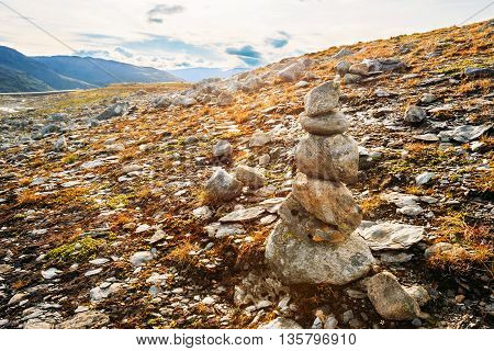 Stack Of Stones On Norwegian Mountain, Norway Nature. Nobody. Travel And Hiking Concept.