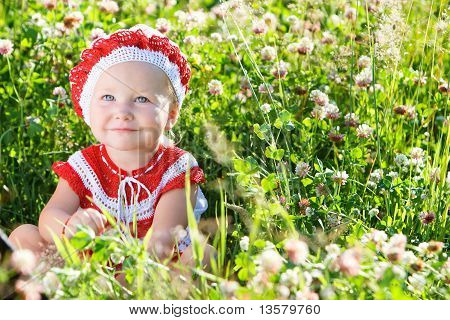 Portrait Of Toddler Girl In Meadow