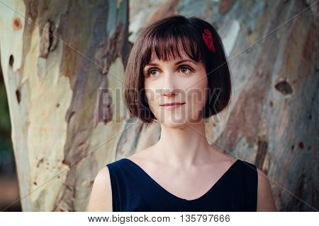 Cute beautiful Woman with Bob Hairstyle Outdoors