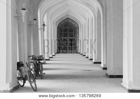 Bicycles through the arches in the courtyard of a mosque in Bukhara.