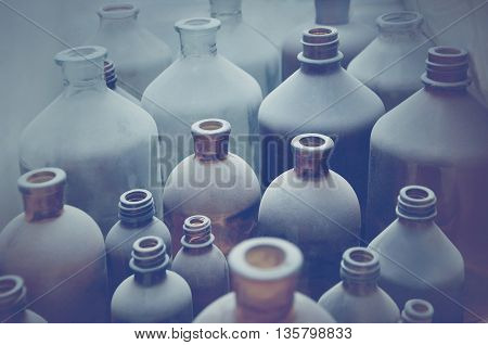 old pharmacy bottles covered with dust in pharmaceutical laboratory