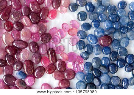 pink rose quartz and Kyanite. circle-shaped polished on white background