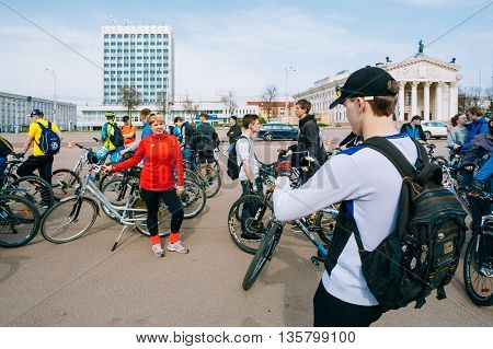 Gomel, Belarus - April 10, 2015: Young man cyclist taking photo on smartphone at opening of the cycling season in the city