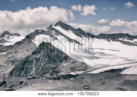 elbrus region mountain with ice. sky with clouds.