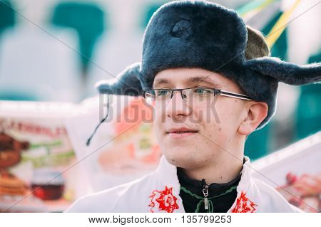 Gomel, Belarus - March 12, 2016: Portrait of unknown happy young man in funny national russian folk clothes at Celebration of Maslenitsa Shrovetide holiday.