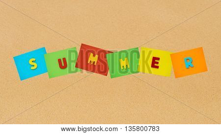 Colorful of summer word on sand beach at sea. Summer time at sea beach concept.