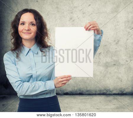 Businesswoman Presenting White Blank Paper Sheet