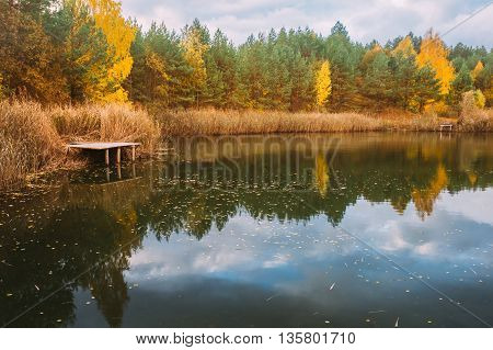 Old Small Wooden Pier For Fishing And Beautiful Lake Or River