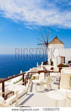Windmill and blue Aegan sea at Oia, Santorini, Greece