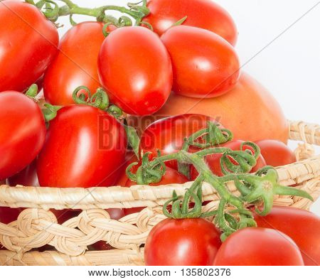 Bunch of red tomatoes in a basket