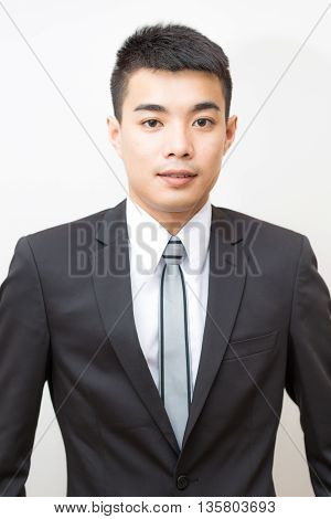 Asian Handsome Smart Young Business Man On Black Suit Smilling