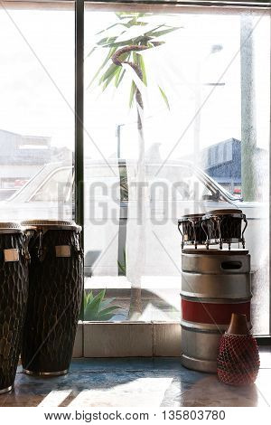 Musical Instruments Including Bongo And Drums In A Room