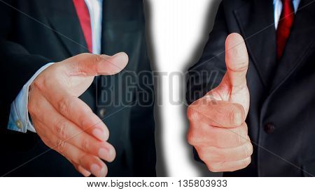 Businessman showing sign handshake and gesturing Thumbs up.