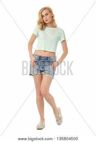 Beauty blonde woman in short shorts isolated on white background