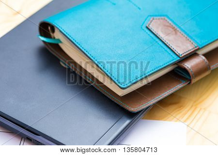 Laptop Computer And Stationary Book On Wood Table