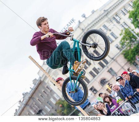 KHARKOV UKRAINE - JUNE 11 2016: Extreme high jump on a bicycle