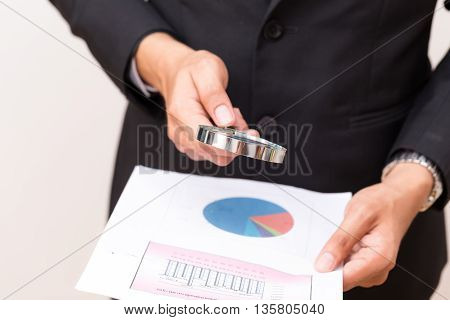 Close Up Portrait Of Handsome Young Man Reading A Chart Report Through A Magnifying Glass