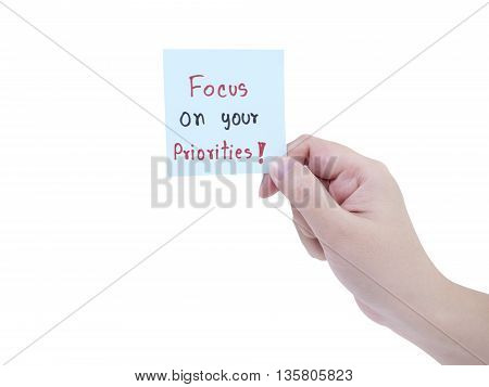 Single smart business woman hold handwriting Focus on your priorities on notepad in right hand on isolated/white background with clipping path