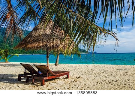 This Is The Vacation Time Show Wood Chairs On A Beautiful Tropical Beach With White Sand