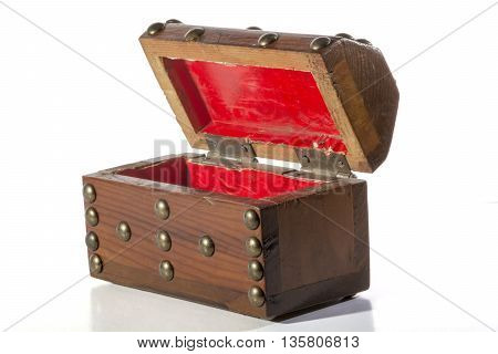 wooden chest on isolated white background with reflection.