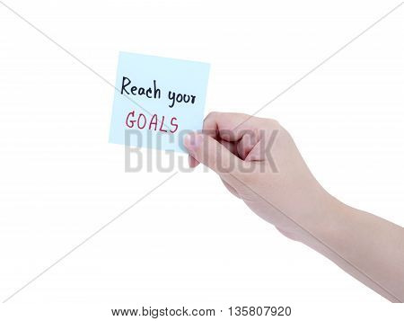 Single smart business woman hold handwriting Reach your goal on notepad in right hand on isolated / white background with clipping path