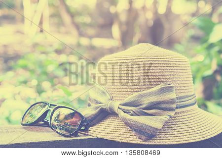 sunglasses and hat on bokeh background,summer concept,close up sunglasses and hat,vintage tone